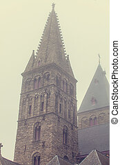 Old church in fog