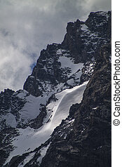 Snow on Mt. Moran - A snow drift on the side of Mt. Moran in...