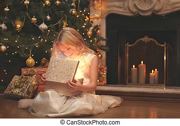 Christmas, magic, people concept - happy child opens the magic b