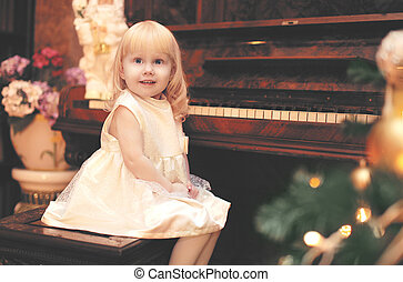 Holiday, christmas and people concept - charming little girl...