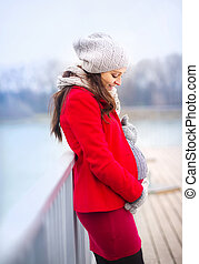 Pregnant woman in winter - Pregnant woman in knitted clothes...