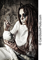 Horror scene: strange crazy girl with moppet doll and needle...