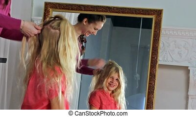 Young girl hairdressing