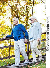 Confident senior couple Full length of happy senior couple...