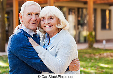Love forever Happy senior couple bonding to each other and...
