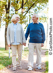 We love spending time together. Happy senior couple holding...