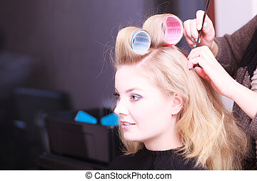 Beautiful blond girl hair curlers rollers hairdresser beauty...
