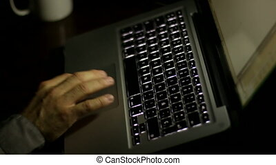 Laptop After Hours Working - Businessman writing on his...