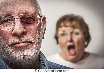 Battered and Scared Man with Screaming Woman Behind -...