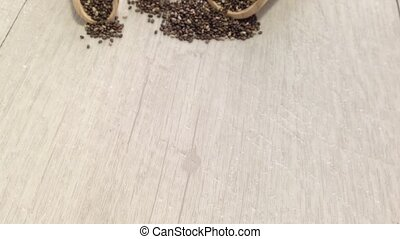 Chia seeds - Background and scoop of chia seeds on wooden...