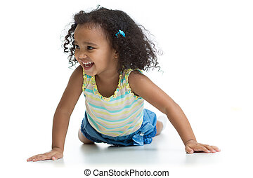Happy kid girl lying on floor and playing isolated