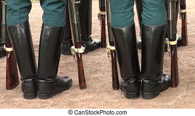 Formation of soldiers. Boots, rifle butts.