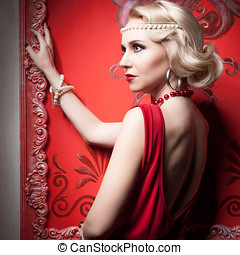 Fashion woman red dress in vintage room
