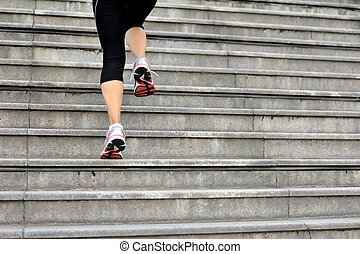 sports woman legs running on stairs - sports woman legs...