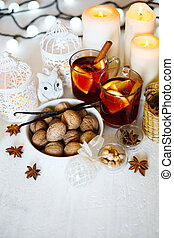 Christmas background with mulled wine, walnuts, candles and...