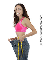Happy successful weight loss woman - Young attractive woman...