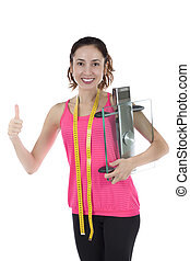 Woman successful in weight loss holding a glass scale -...