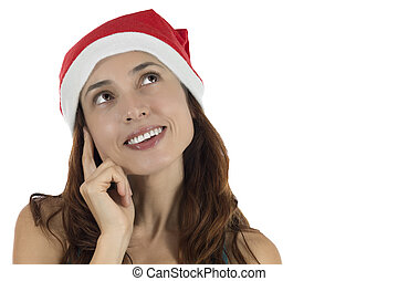 Happy looking Christmas woman thinking and dreaming -...
