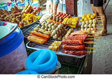 Street food in Thailand fried sausages and meatballs -...