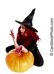 witch with bloodstained hands sits on a pumpkin
