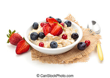 Oatmeal. - Oatmeal and fresh fruits isolated on white...