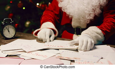 Letter to Santa - Tilt up from heap of letters to Santa...