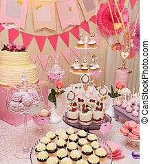 Sweet holiday buffet with cupcakes and meringues - Delicious...