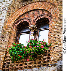 Floral old window of Tuscany town - Old palace windows...