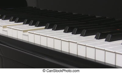 Piano keyboard keys playing - Close up of grand piano...