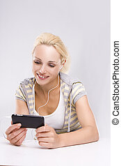 An attractive woman checking her cell phone