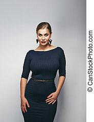 Attractive young plus size female model - Portrait of pretty...