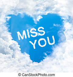 miss you word on blue sky inside heart cloud form