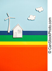 House model and windmill on colorful background