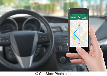 Smartphone with map gps navigation app on the screen in...
