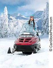 Portrait of female on snowmobile - Portrait of woman on...