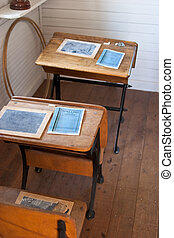 Heritage school desks - Row of heritage school desks with...