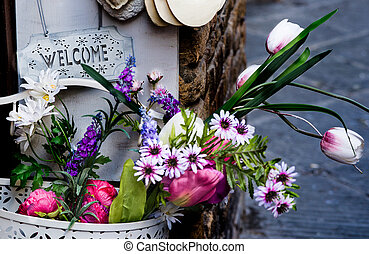 Welcome in Tuscany - Artificial flowers at the entrance of...
