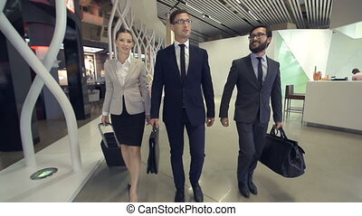Business Travel - Slow motion of three business people...
