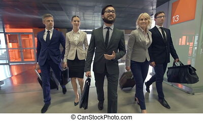 Business Leader - Business team of five approaching camera...