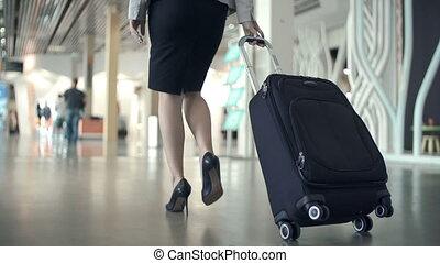 Elegant Tread - Low section of business woman walking with...