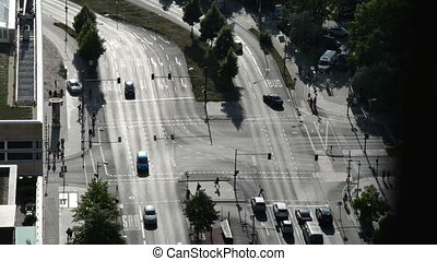 cars driving at crossroads multi lane traffic in a city