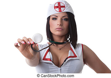 Portrait of sexy unsmiling nurse with stethoscope, isolated...