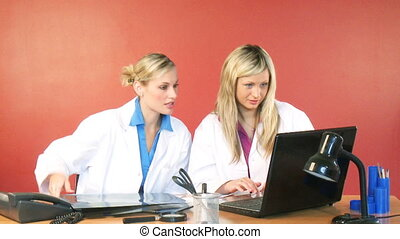 Female doctors working in office footage - Attractive blonde...