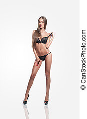 fashion model with long hair in black lingerie