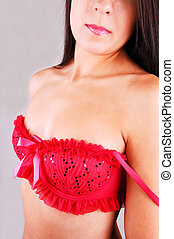 Young woman in red bra.