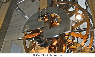 clockwork of an old tower clock with huge gears. Located in...