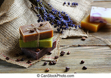 Handmade soap on wooden boards with coffee beans, toiletries...