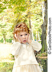 Suprised child - Little girl showing suprised face outdoor