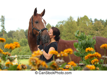 Portrait of woman with horse in flowers - Portrait of woman...