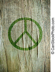 Peace sign printed on a tree trunk